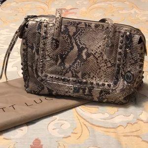 Elliott Luca studded metallic snakeskin handbag.
